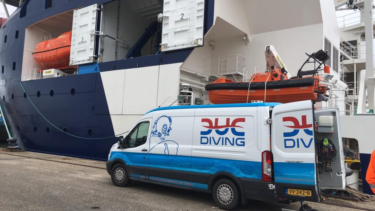 Picture of a diving van, next to a big offshore vessel. Ready to perform In-Water inspection.